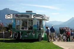 photo of cowmobile set up for ice cream vending at a special event